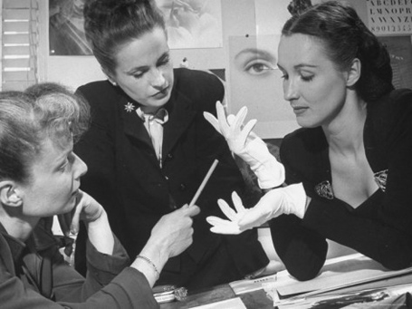 nina-leen-maeve-brennan-of-harpers-bazaar-examining-a-pair-of-white-gloves