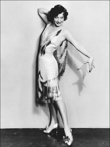Joan-Crawford-models-a-flapper-dress